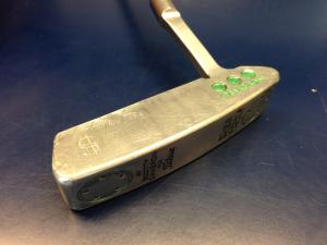 Money putter deep engraved